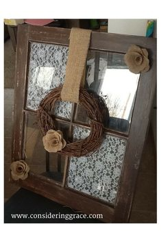 Old window done with lace, and burlap flowers