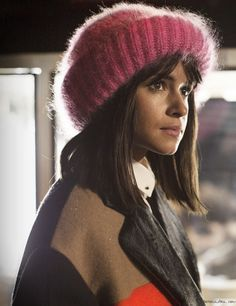 Miroslava Duma, pink ribbed hat, multicolor coat