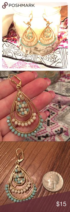 Mint and cream beaded hoop earrings boho These beaded hoop earrings are so pretty! Great hippie/boho vibe. Gold tone wire and closure with mint/seafoam green and cream beads. Excellent like new condition. Only worn once. 🚫trades 🚫modeling. Save 15% when you bundle 2 or more listings. Jewelry Earrings