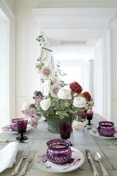 This table setting, set up in the vestibule of Carolyne Roehm's home, showcases the incredible porcelain flowers of Vladimir Kavenesky. They are so beautiful with the amethyst china & crystal.