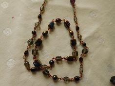 "30"" Long Bronze necklace with purple/ brown glass beads. by DesignImagesLLC on Etsy"