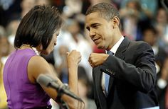 Barack and Michelle Obama bump fists before his victory appearance Tuesday night in St. Paul, Minnesota.  Craig Lassig / EPA