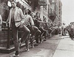 1961, at the Movie set of the West Side story. Male actors(dancers) taking ballet class on the side. :)