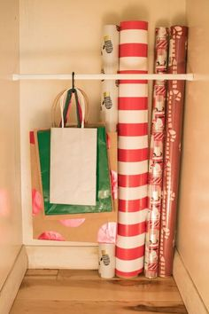14 Ways to Organize Your Wrapping Paper and Gift Bags Tame your unruly wrapping zone, and consider some of these ideas for organizing gift bags and rolls of wrapping paper. Gift Bag Organization, Gift Bag Storage, Wrapping Paper Organization, Gift Wrapping Supplies, Craft Storage, Wrapping Papers, Storage Ideas, Wrapping Paper Station, Organizing Gift Bags