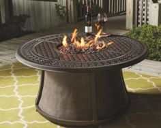 Burnella Outdoor Round Chat Fire Pit Table by Ashley HomeStore, Orange/Brown