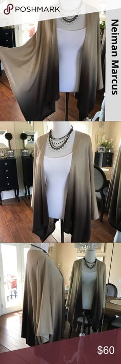 """NEIMAN MARCUS Ombré poncho/cardigan Silky swingy knit this poncho style cardigan has a cool ombre affect starting w/ a camel color tan graduating to chocolate brown. Tag says size M but runs small, better suited for an XS. Fabric content tag is missing but it a luxurious knit. Great condition. I'm 5'3 an XS & front hem hits me 2"""" above the knee. If you're taller it will be shorter on you. Neiman Marcus Sweaters Shrugs & Ponchos"""