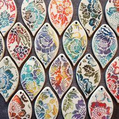 Porcelain pendants with watercolor glaze technique. | by RoundRabbit