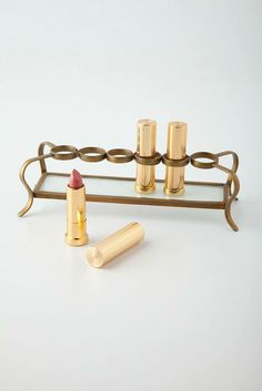 To the woman who taught you how to put lipstick on properly, this vintage-looking lipstick holder ($28) is the perfect gift.