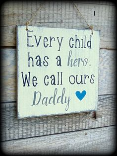 """Every child has a hero, we call ours Daddy."" This adorable, rustic sign makes a great gift for daddy for any occasion. Each sign is handcrafted, hand painted, and distressed to give a very rustic loo"