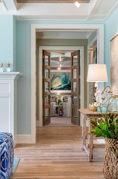 Hallway decorating ideas. Hallway coastal decor. Hallway with blue walls, bleached plank floors and coastal decor. #hallway Great Neighborhood Homes.