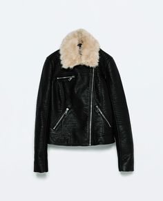 Very cool moto jacket in faux leather - white (faux!) fur collar lends a nice contrast and softens it up a bit.
