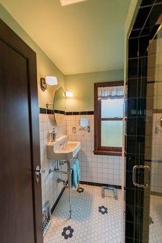Black and white tile bathroom built new, 1930s style