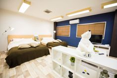 "Apartment in Ōsaka-shi, Japan. This room is the best place to stay for ""Universal Studios JapanOnly 7mis to ""Universal Studios Japan"" - whole floor will be yours - best room for family, group trip  Welcome to Osaka!!!        I am Risa.     Thank you very much for looking at my ..."