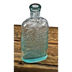 "all original and completely intact heavily embossed early 20th century aqua blue glass ""e-z polish"" bottle fabricated for martin & martin of chicago, il."