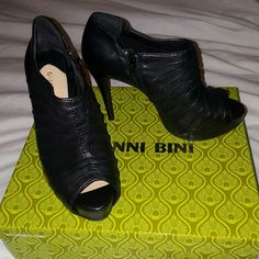 NIB Black Chaeli Ankle Boots by Gianni Bini Size 8 These Sexy Ankle Boots are Black, Peep-Toe, & Zip on the inside. There is about an inch platform with approximately 4 inch pencil heel!!! Exact measurements Upon Request. These are definitely some head turners!!! I hate to sell, but I've yet to wear them & they're just sitting in my closet. My loss is your gain. I purchased these from Dillard's for $98 (before tax). Feel free to make me an offer. No low-balling please. Gianni Bini Shoes…