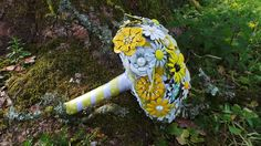 A fresh yellow brooch bouquet, handmade with vintage enamel brooches.