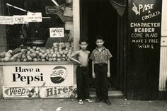 """""""Character Reader,"""" boys in front of supermarket on Eighth Avenue near 23rd Street. Photograph by Arthur Grumbine, ca.1957-1960. Gift of Arthur Grumbine, New-York Historical Society 83593d."""