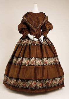 This dress is American, but right from my novel's period (1854). I noticed the elaborate layering of the bodice and sleeves...cumbersome even for this cumbersome period!