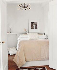 simple bedroom with sputnik light and nude duvet