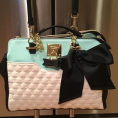 "Gorgeous Betsey Johnson bag a must have Mint green, cream and black with gold hardware. It has black large ribbon on front with gold key lock with black ribbon. It has 2 zipped pouches and a large pouch in the middle. It has gorgeous red and pink signature BJ lining with pink lips. Size is :length is 12"", height 9"", depth 6"". It has a shoulder strap so you can use on shoulder or CROSSBODY plus it has chain handles. This bag is brand new but it has no Tags. Betsey Johnson Bags Shoulder Bags"
