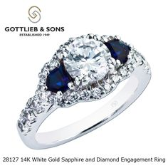 Just #SayYes to this magnificent Diamond and Sapphire engagement ring. This impressive #diamond engagement ring has lovely #blue #sapphires on both sides of the center diamond.  This ring is perfect for brides who want to incorporate their September #birthstone into their #engagement ring. Visit your local #GottliebandSons retailer and ask for style number 28127.