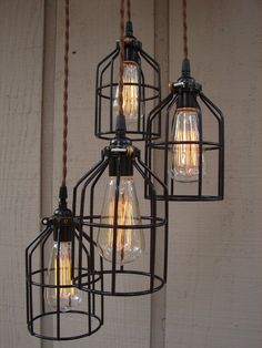 Multi-drop 3 black light steel open wire cage industrial hanging pendant shade lamp colour cable, squirrel cage vintage style filament bulb by TheVintageTwistCo on Etsy https://www.etsy.com/listing/182973290/multi-drop-3-black-light-steel-open-wire
