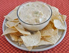 Fix-It and Forget-It Creamy artichoke dip is perfect for a quick game day snack! Don't you love fall and football season?!