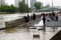 A couple in wedding clothes poses along the flooded River Seine on June 3, 2016 in Paris, France. Th... - Thierry Chesnot/Getty Images