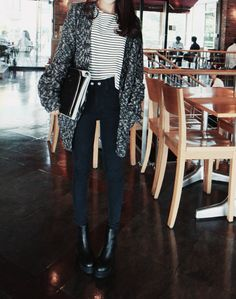 Black and white striped shirt, grey and white marled cardigan, black high-waist skinny jeans, black boots