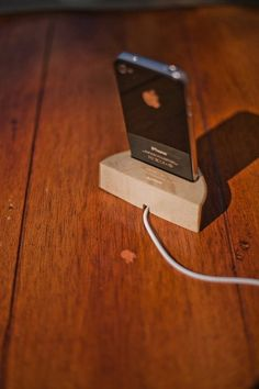 Once again, we find that we have an iPhone exclusive product, it is a bit annoying but what can you do about it? Well anyway, this dock is made from a solid piece of wood that is a bit like … Tablet Stand, Handmade Wooden, Apple, Electronics, Iphone, Natural, Apple Fruit, Nature, Apples