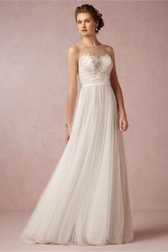 Chic, Sophisticated Wedding Dresses for Romantics: The Penelope gown has all the elements of a fairytale gown: soft illusion neckline, floral-covered bodice, flowing tulle skirt, sweeping train, and a sash to tie it all off. http://www.confettidaydreams.com/chic-sophisticated-wedding-dresses/