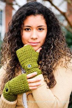 5 green crocheted wrist warmers with buttons