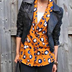 Philip Lim blazer Bright pattern! It's like a rusty orange color. It has blue and white leopard spots on it. It has buttons for closure and faux pockets. Full length sleeves. 100% polyester. 3.1 Phillip Lim for Target Jackets & Coats Blazers