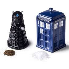 This is from the TV show Doctor Who The one on the left is called a Dalek, and the one on the right is a TARDIS, which is the space ship the Doctor travels in. (Time And Relative Dimension In Space)