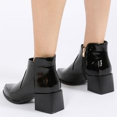 Update your daily fave ankle boots with a statement square cube heel. Wendy sits low on the ankle with a slightly pointed toe so these are great for pairing with skinny jeans. The high shine finish gives a touch of luxe to any get up. Disclaimer: You do risk being asked 'Where did you get those?' on a very regular basis!   Heel Height: 2.4 Shoe Height: 6.5\