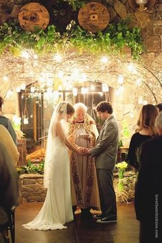 Mason jar lights and branches above us if we have to do vow renewal indoors