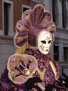 Purple and gold.  Venice Carnival 2014 by Lesley McGibbon