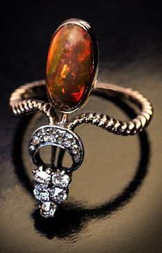 A late Victorian gold, opal and diamond ring, circa 1900.
