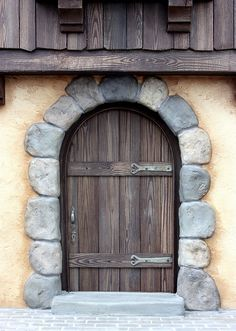 Miniature door - 1/12th scale    Hand painted wood grain. Stones are air dry paper clay..