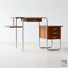 Desk by Marcel Breuer... Needs chair, lamp and a place to land. Simple, beautiful and an entrepreneur's dream for a home office.