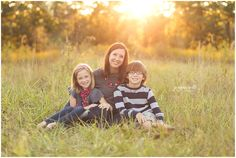 family of three photo ideas; mom with son and daughter posing ideas; family photography in grassy field www.jeannewittphotography.com