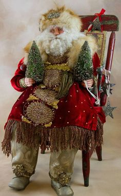 Father Christmas in Chair, handcrafted by Gloria Becker /