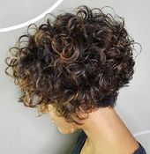 Short Stacked Bob with Voluminous Curls One of the sassiest ways to wear your naturally curly hair is in a short, stacked bob with lots of loops and volume on top and in the back. Each curl is… Haircuts For Curly Hair, Curly Hair Cuts, Short Hair Cuts, Short Permed Hairstyles, Latest Hairstyles, Perms For Short Hair, Bob Haircut Curly, Hairstyle Short, Short Curls
