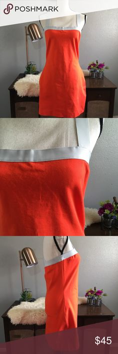 Kate Spade Saturday Orange Bodycon Form Fitting Flawless like new Kate spade dress. Vibrant orange color with thick gray edges and straps that cross cross in the back. Size medium runs a bit large fits more like large/medium. Made of 84% cotton 14% nylon 2% elastane. Free of stains tears and holes kate spade Dresses Midi