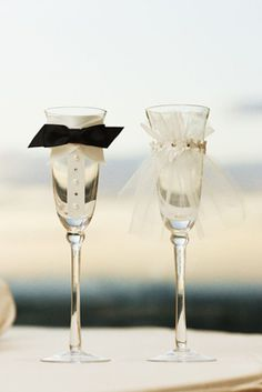 Turn boring old Champagne flutes into his-and-hers glasses by adding a bow tie and veil.
