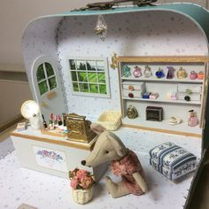 Escape into the tiny world of wonders. by LittledreamscapesCo Dollhouse Furniture, Home Furniture, Upholstered Stool, Tiny Studio, Doll Shop, Flower Basket, Pastel Blue, Soap Making, Suitcase