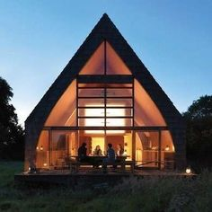"""""""Glass Curtain"""" A-Frame with a windowed front wall, open plan and curved interior walls."""
