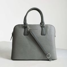 """SALE‼️David Jones Gray Overnight Bag Classic + structured cross-grain vegan leather bag from David Jones Paris. With a organized & floral-print lined interior + removable & adjustable shoulder strap + outer zip pocket.  Content & Care - PVC, textile - Spot clean - Imported  Size - Length: 13.5"""" - Width: 6"""" - Height: 10""""  Item's color may vary from photos, photos were photographed by me.  USE THE OFFER BUTTON IF YOU WANT TO NEGOTIATE PRICE + NO TRADES Bags Shoulder Bags"""