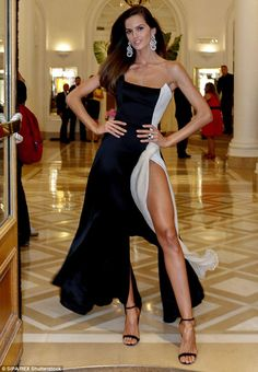 Racy: Izabel flashed her legs in a flowing gown with a dramatic thigh-high split...