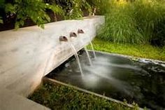 The fountain shape of these grasses mimic the water pouring outof this lovely water feature. Outdoor Living Space Finalist in the 2015 Gardenista Considered Design Awards Backyard Garden Design, Backyard Landscaping, Backyard Water Feature, Water Features In The Garden, Garden Fountains, Canal E, Garden Structures, Water Garden, Design Awards